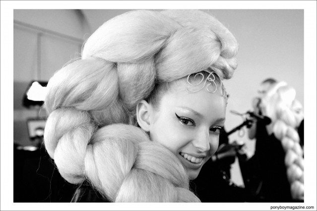 A model in an oversized braid, backstage at The Blonds S/S15 collection at Milk Studios in New York City. Photographed by Alexander Thompson for Ponyboy Magazine.