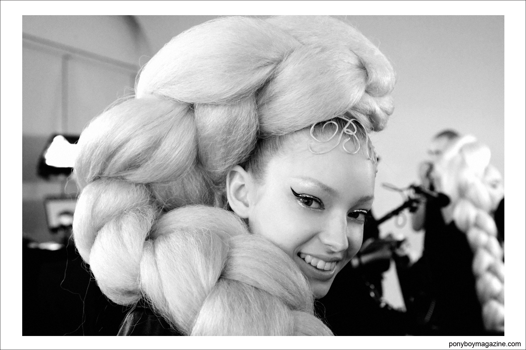 A model in an oversized braid, backstage at The Blonds S/S15 collection at Milk Studios NY. Photographed by Alexander Thompson for Ponyboy Magazine.
