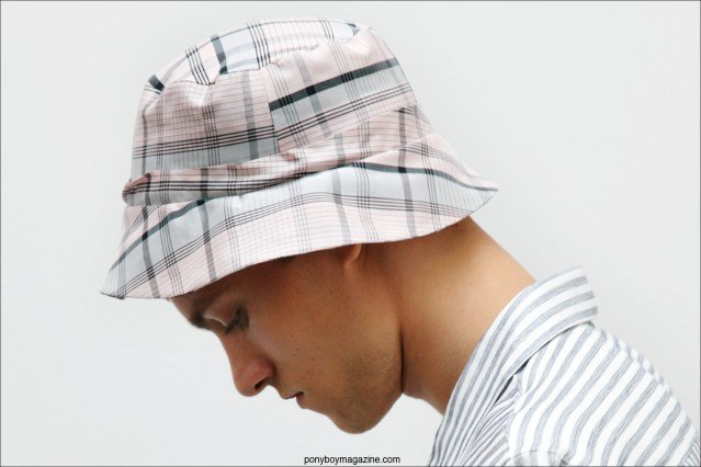 A male model wears a plaid bucket hat for Spring/Summer 2015, designed by Duckie Brown. Photo by Alexander Thompson for Ponyboy Magazine.