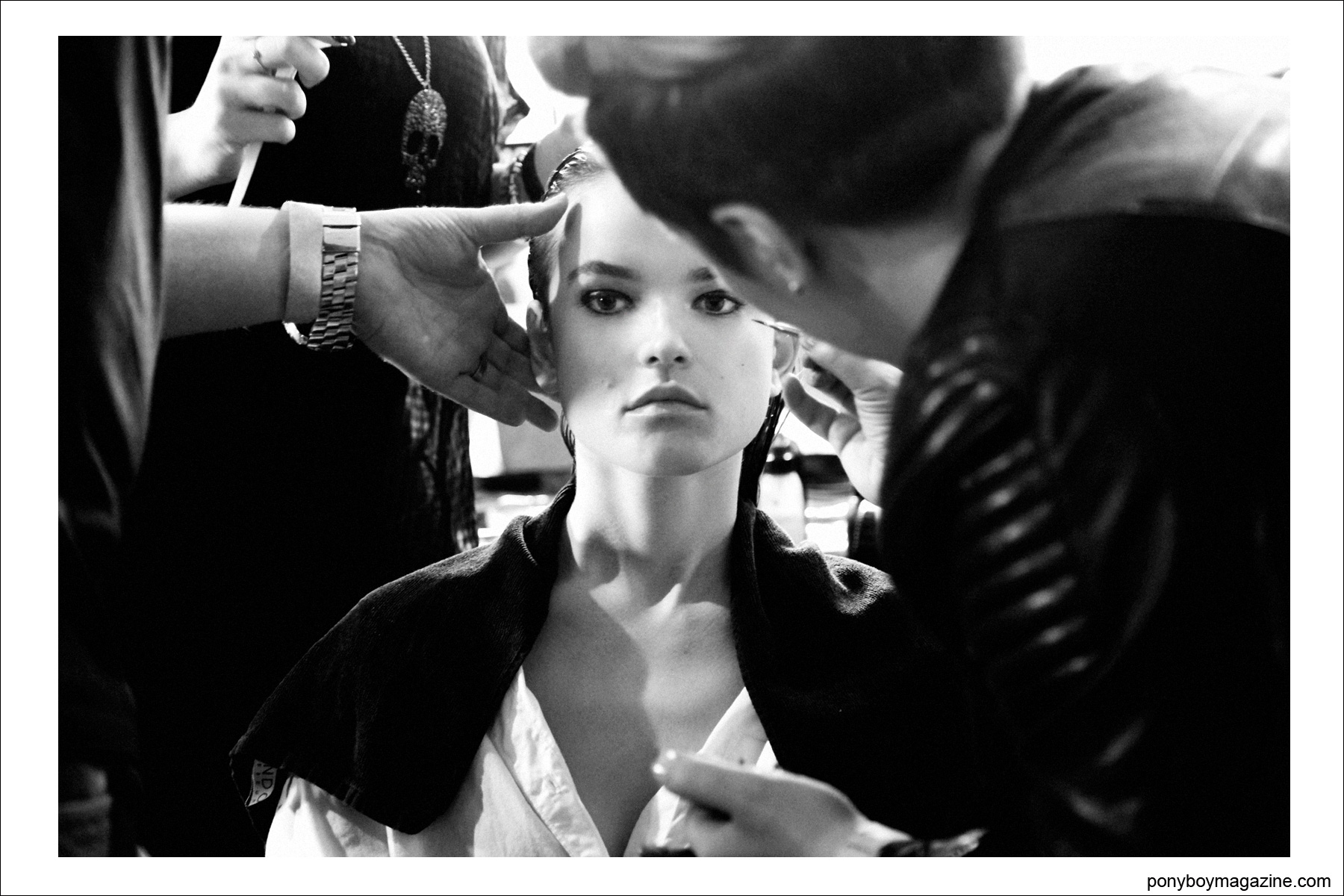 A model backstage during makeup at Sophie Theallet S/S15 collection. Photograph for Ponyboy Magazine by Alexander Thompson.