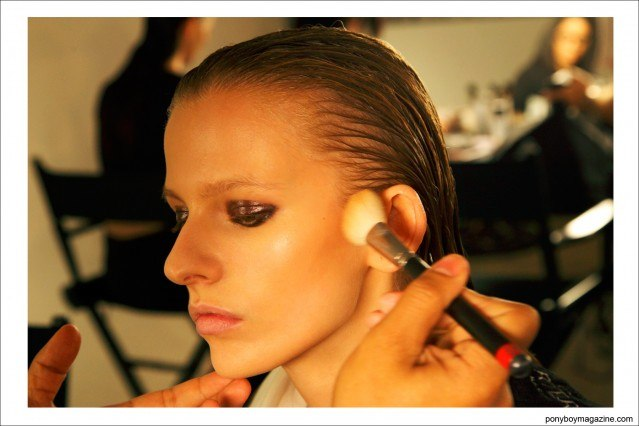 A model gets her makeup applied backstage at Sophie Theallet Spring/Summer 2015 show at Milk Studios NY. Photograph by Alexander Thompson for Ponyboy Magazine.
