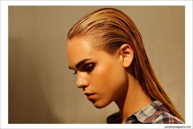 Slicked back wet looking hair backstage at Sophie Theallet S/S15 at Milk Studios NY. Photograph by Alexander Thompson for Ponyboy Magazine.