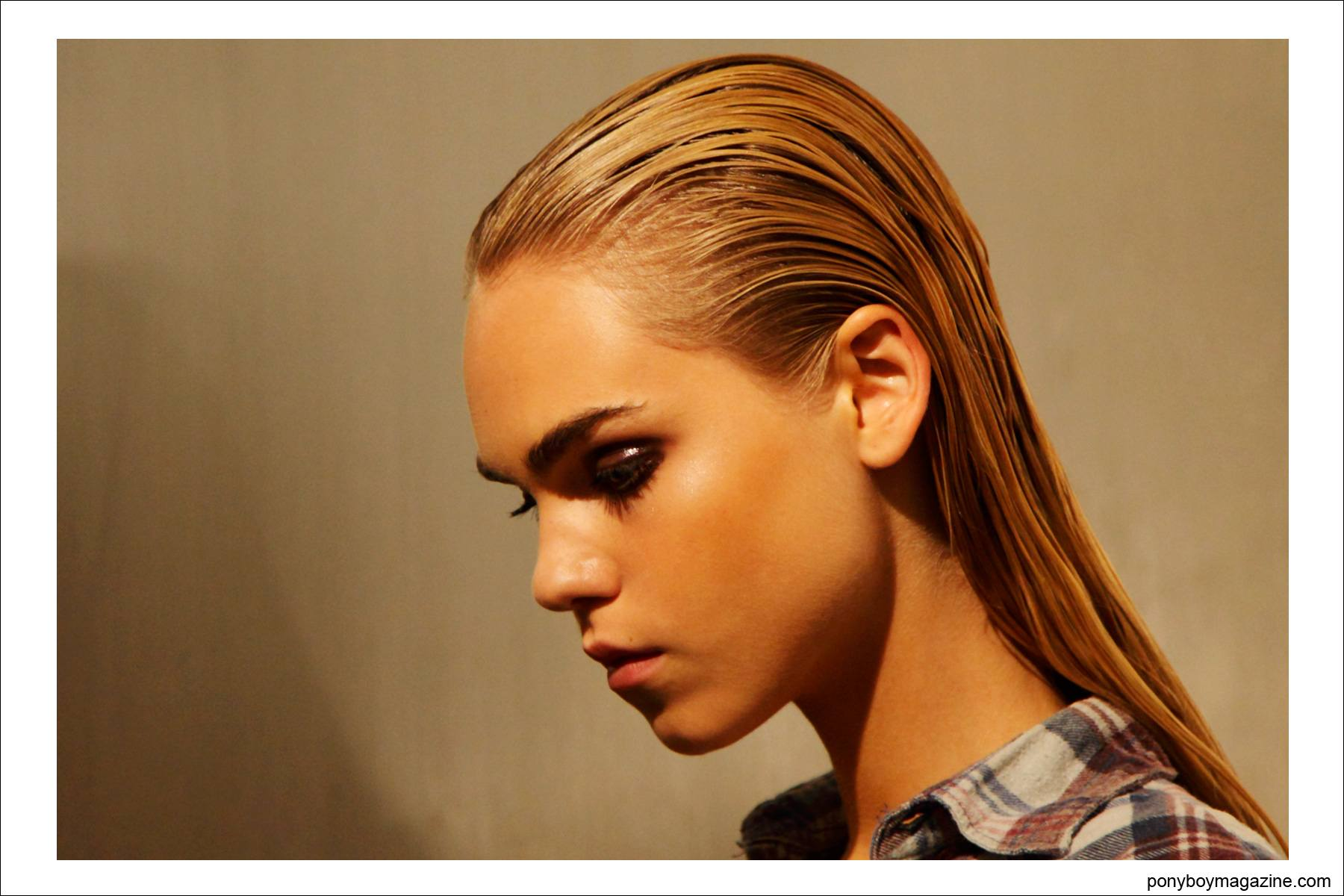 Slicked back wet looking hair backstage at Sophie Theallet S/S15 at Milk Studios NY. Photo by Alexander Thompson for Ponyboy Magazine.