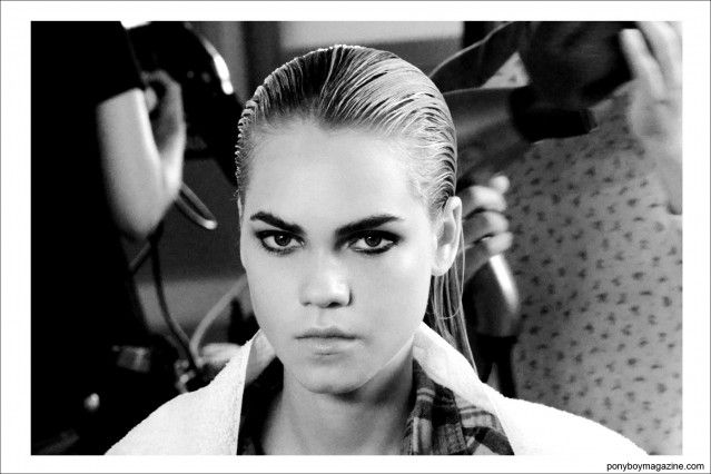 A model snapped backstage at hair for Sophie Theallet S/S15. Photograph by Alexander Thompson for Ponyboy Magazine.