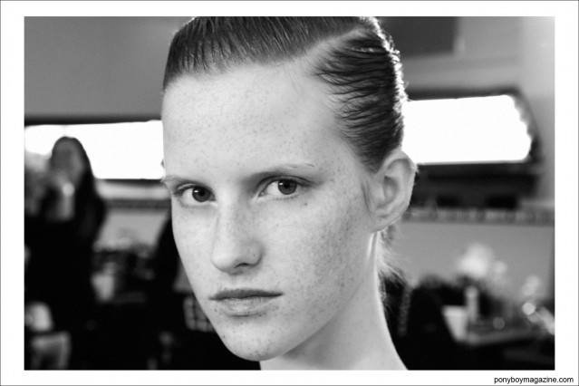 A freckled face model backstage at Peter Som S/S15 in New York City. Photo by Alexander Thompson for Ponyboy Magazine.