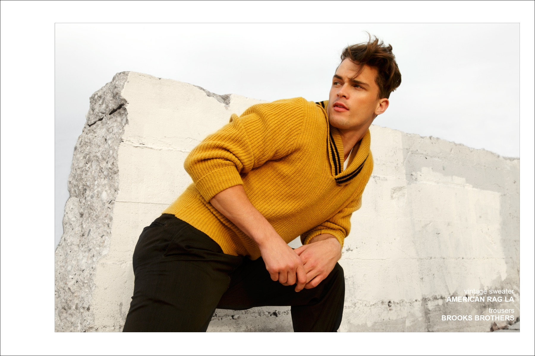 Male model Dutty Wruck wears a vintage sweater and trousers from Brooks Brothers for Ponyboy Magazine men's editorial