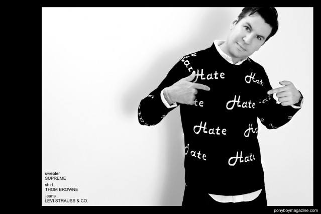 "Editor Peter Davis wears a ""hate"" sweater by Supreme. Photographed in New York City by Alexander Thompson for Ponyboy Magazine."