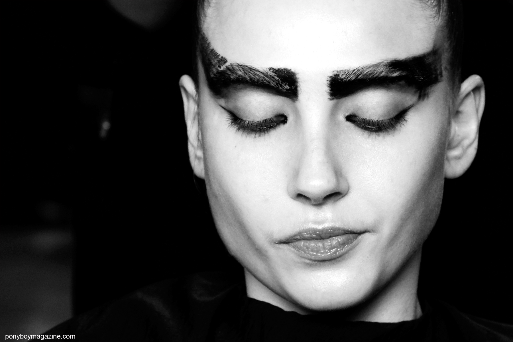 Dramatic bold eyebrows, photographed backstage at Chromat F/W15 collection at Milk Studios. Photographed by Alexander Thompson for Ponyboy magazine.