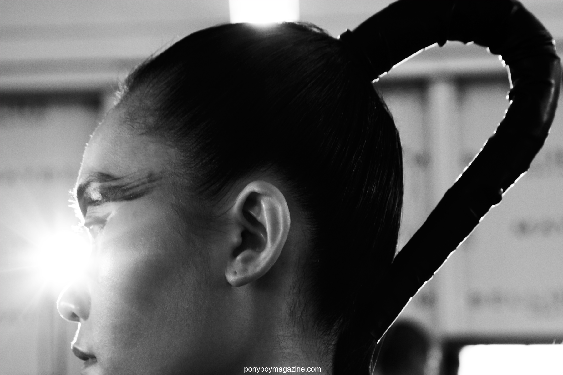 A modern futuristic ponytail photographed backstage at Chromat F/W15 collcetion at Milk Studios. Photograph by Alexander Thompson for Ponyboy magazine.