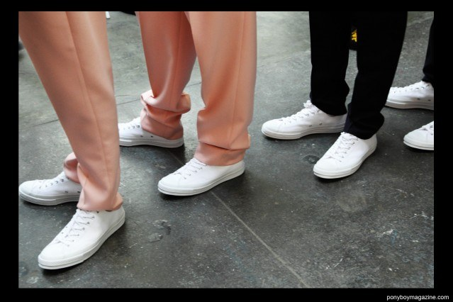 Models in Converse tennis shoes, backstage at Duckie Brown F/W15 show at Industria Studios. Photo by Alexander Thompson for Ponyboy magazine.