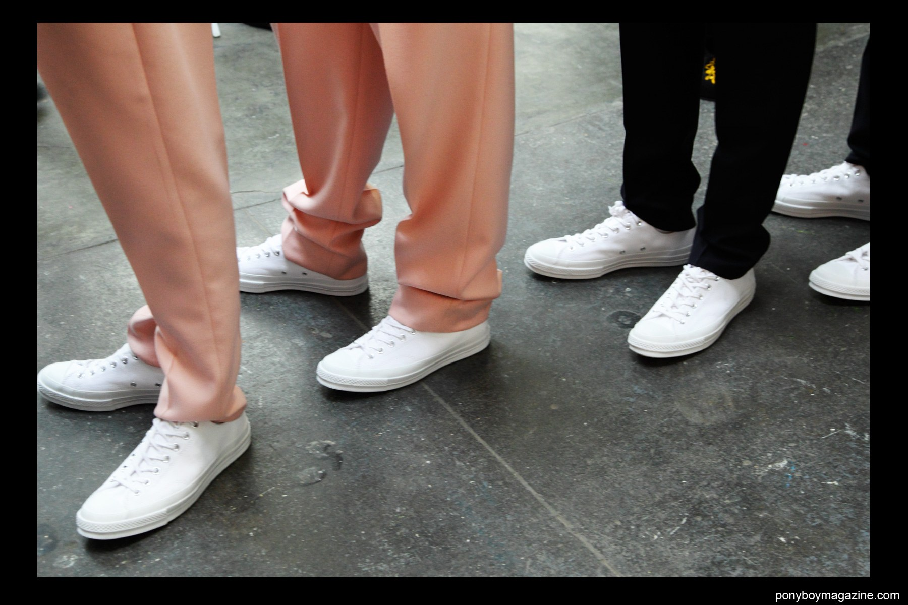 Models in Converse tennis shoes, backstage at Duckie Brown F/W15 show at Industria Studios. Photograph by Alexander Thompson for Ponyboy magazine.