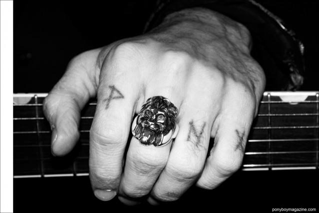 Close up shot of musician Justin Dean Thomas' tattooed knuckles. Photographed for Ponyboy magazine by Alexander Thompson.