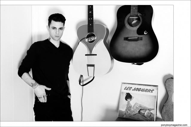 New York musician Justin Dean Thomas, photographed in front of his guitars by Alexander Thompson for Ponyboy magazine.