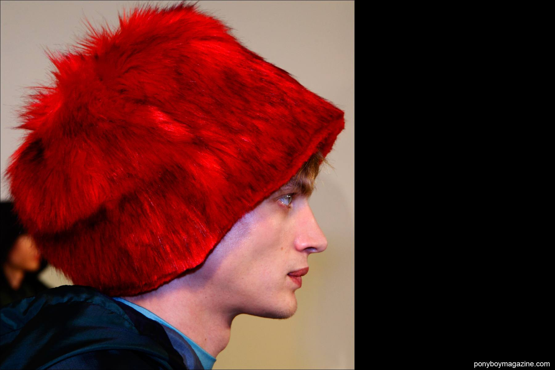 A red fuzzy hat at the Bobby Abley F/W15 presentation at Milk studios NY. Photograph by Alexander Thompson for Ponyboy magazine.