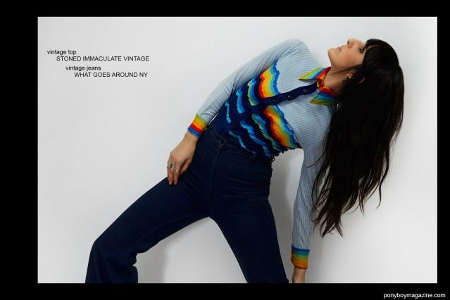 Kristin Gallegos wears a vintage top by Stoned Immaculate Vintage, and vintage jeans from What Goes Around. Photo by Alexander Thompson for Ponyboy magazine.