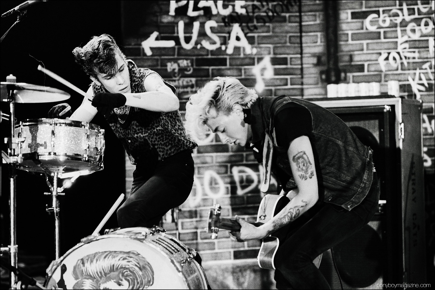 Slim Jim Phantom and Brian Setzer, from 80's rockabilly band Stray Cats, photographed onstage by Manfred Becker. Ponyboy magazine NY.