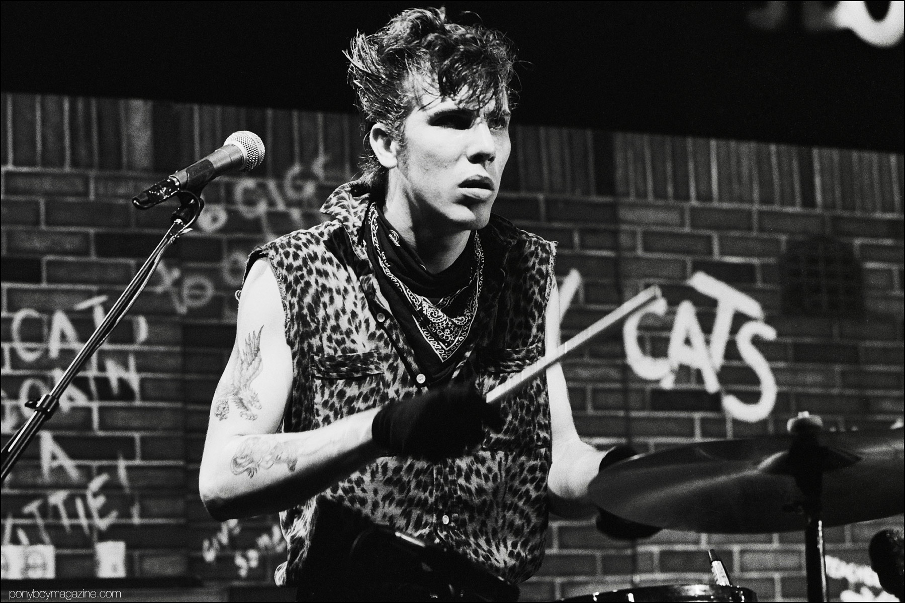 Slim Jim Phantom, drummer for neo-rockabilly band Stray Cats. photographed by Manfred Becker. Ponyboy magazine NY.