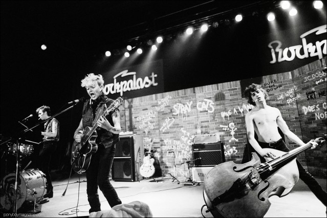 Neo-rockabilly band Stray Cats, onstage in Germany. Photographed by Manfred Becker. Ponyboy magazine.
