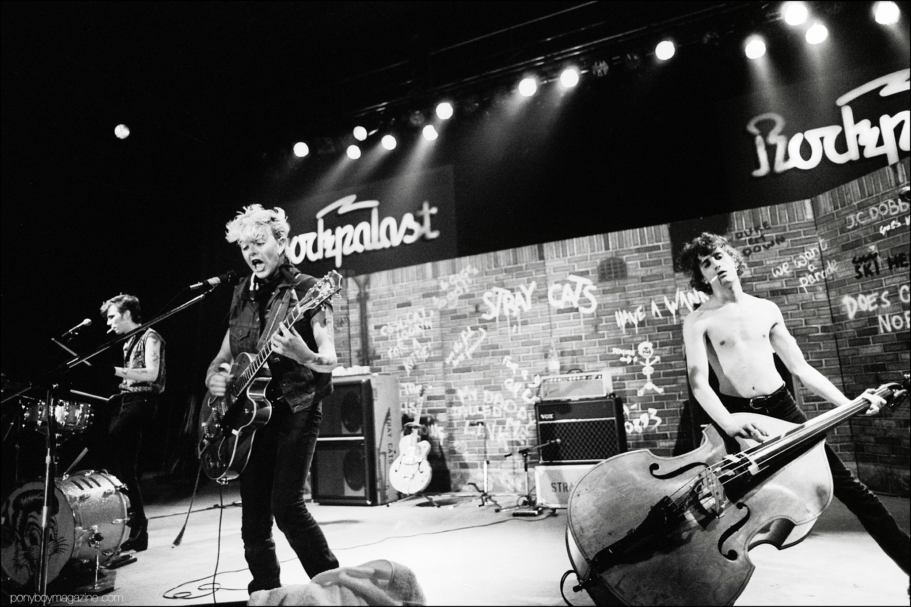Neo-rockabilly band Stray Cats, onstage in Germany. Photographed by Manfred Becker. Ponyboy magazine NY.