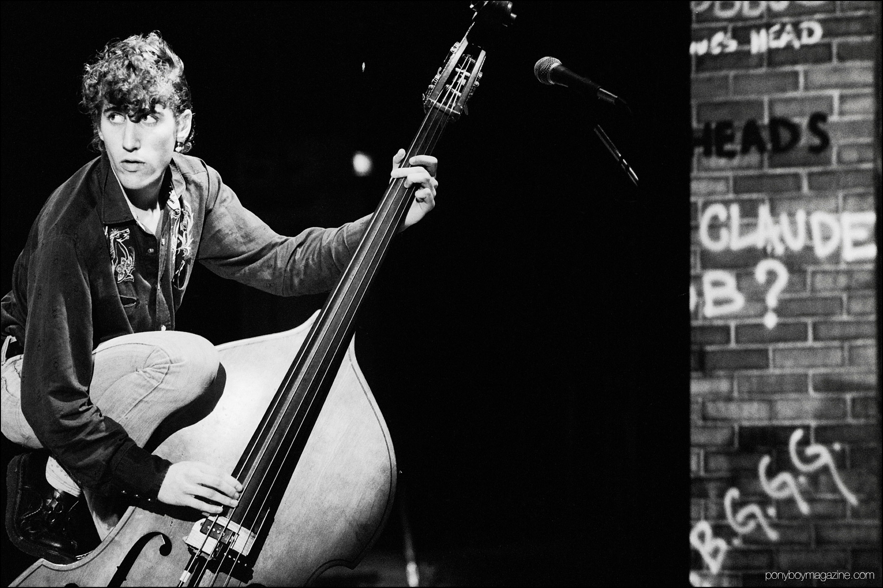 Neo-rockabilly bassist Lee Rocker, photographed by Manfred Becker onstage in Germany. Ponyboy magazine NY.