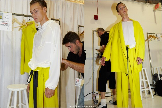 Model Tom Gaskin wears an electric yellow oversized suit, backstage at Duckie Brown Spring/Summer 2016 menswear show. Photography by Alexander Thompson for Ponyboy magazine.