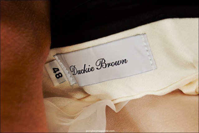 Closeup shot of Duckie Brown menswear label. Photograph by Alexander Thompson for Ponyboy magazine.