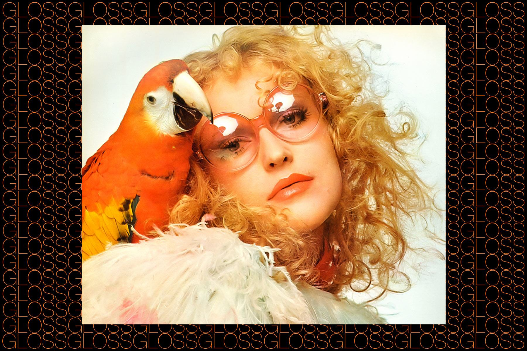 A model with a parrot, photographed by Chris von Wangenheim. From the Rizzoli 2015 book GLOSS by Roger Padilha & Mauricio Padilha. Ponyboy magazine NY.