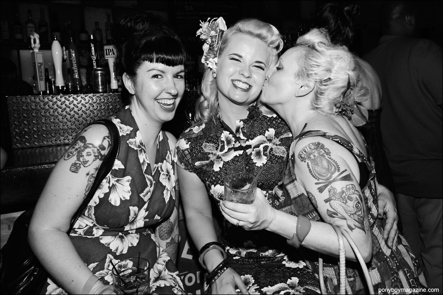 Rockabilly women in Hawaiian print dresses, photographed at Hula Rock Vol 2 in New York City. Photograph by Alexander Thompson for Ponyboy magazine NY.