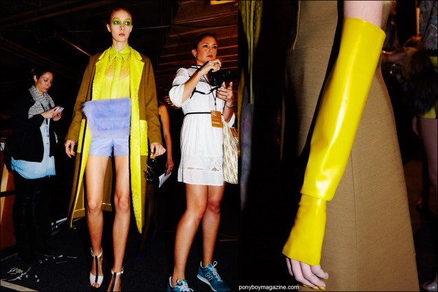 Models in fur fanny packs and rubber arm gauntlets, backstage at Georgine Spring/Summer 2016 womenswear collection. Photography by Alexander Thompson for Ponyboy magazine.