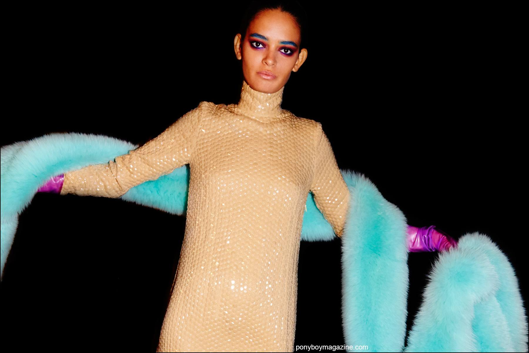 A sequined gown with mint fur stole, photographed backstage at Georgine Spring/Summer 2016 womenswear collection. Photographed by Alexander Thompson for Ponyboy magazine NY.