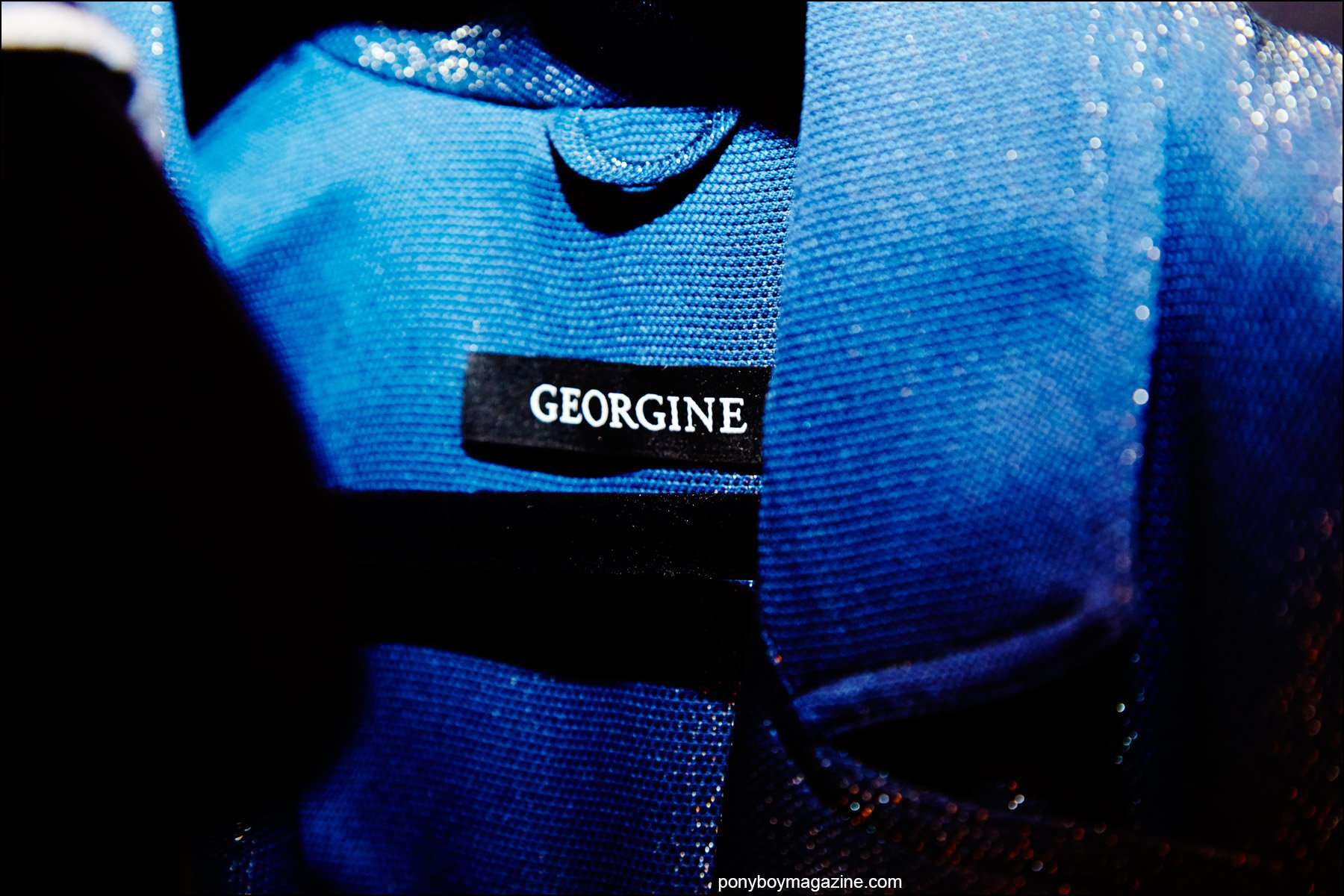 Detail shot of a label on a Georgine jacket, photographed backstage at the Spring/Summer 2016 collection by Alexander Thompson for Ponyboy magazine NY.