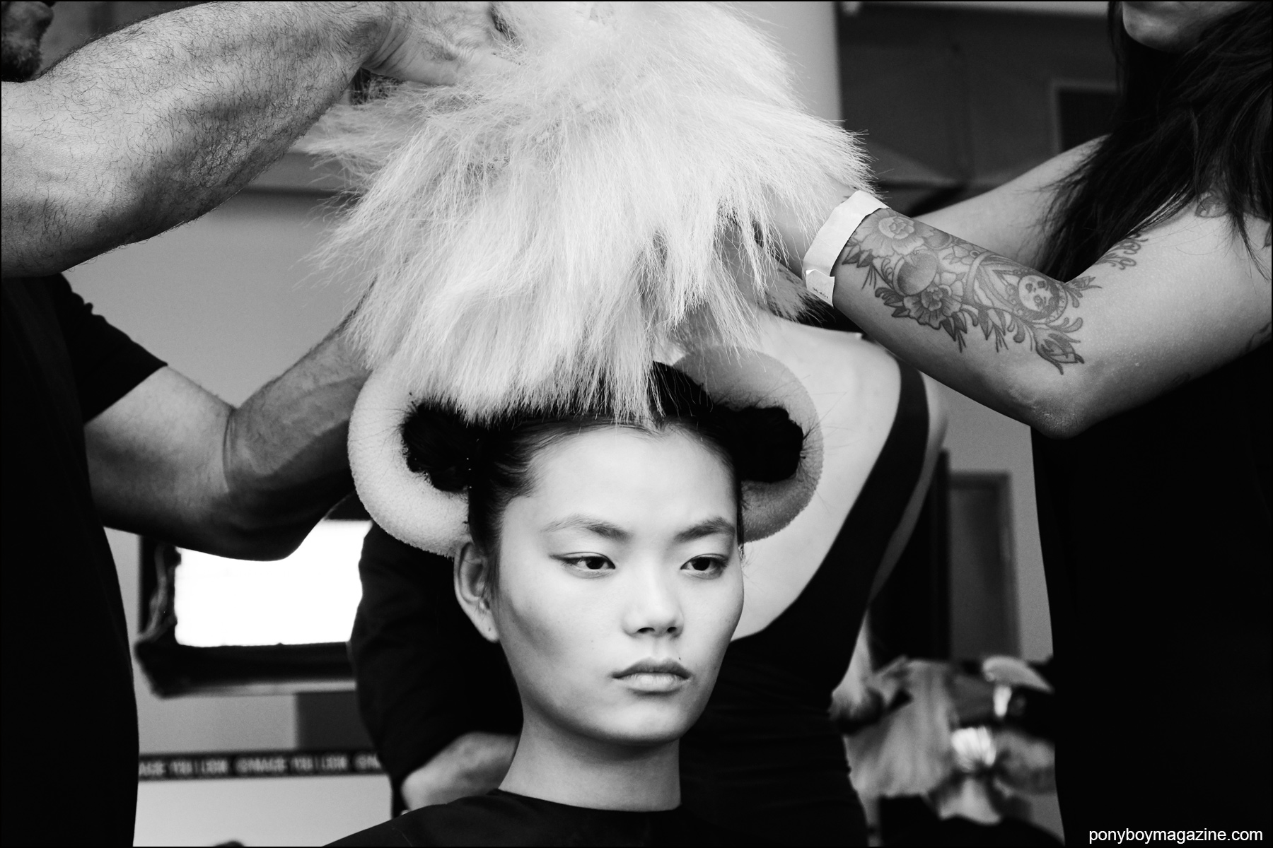 A model gets her wig placed backstage at the Blonds S/S16. Photograph by Alexander Thompson for Ponyboy magazine NY.