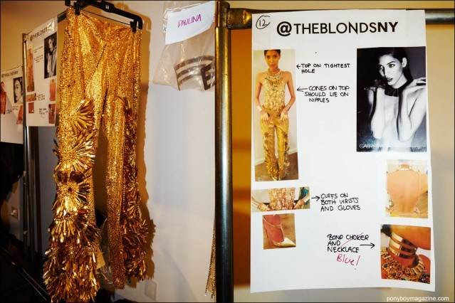 Detail shots of gold trousers and a models comp card, backstage at the Blonds S/S16 runway show. Photography by Alexander Thompson for Ponyboy magazine.