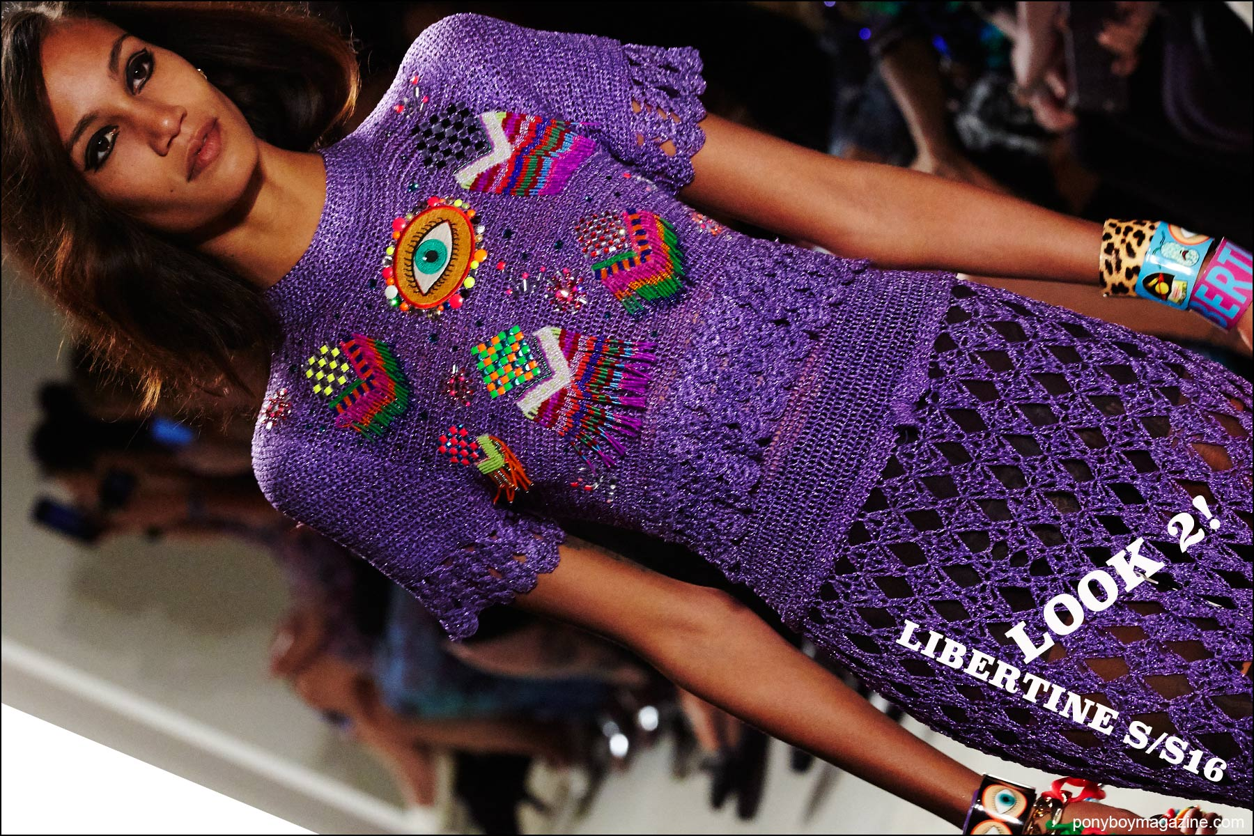 Purple knit applique creation at Libertine S/S16 runway show. Photographed by Alexander Thompson for Ponyboy magazine NY.