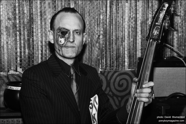 Upright bassist Peter Erickson, photographed at the Midnite Monster Hop party in New York City by David Blumenfeld. Ponyboy magazine.