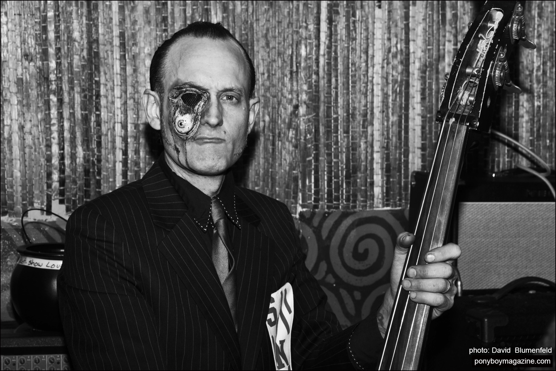 Upright bassist Peter Erickson, photographed at the Midnite Monster Hop party in New York City by David Blumenfeld. Pony boy magazine NY.