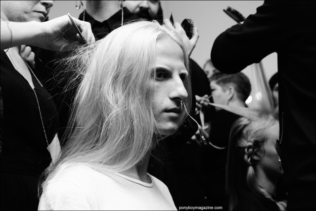 Long-haired male model photographed backstage in hair at the threeASFOUR Spring/Summer 2016 show. Photography by Alexander Thompson for Ponyboy magazine.