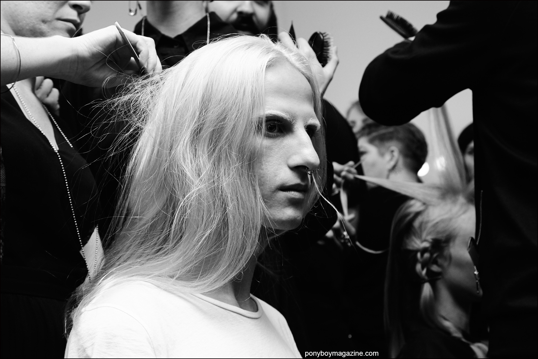 Long-haired male model photographed backstage in hair at the threeASFOUR Spring/Summer 2016 show. Photography by Alexander Thompson for Ponyboy magazine NY.