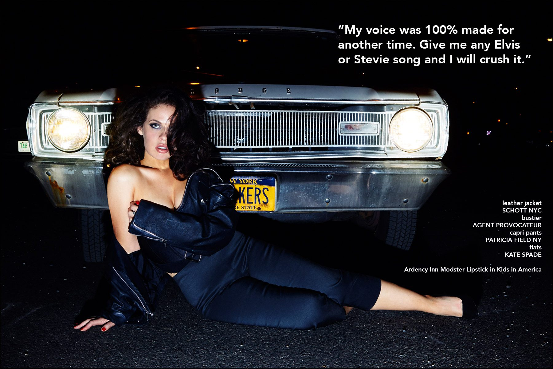 Kelsy Karter photographed in front of a Dodge Dart, wearing a leather jacket by Schott NYC, bustier by Agent Provocateur, capri pants by Patricia Field NY and flats by Kate Spade. Photography by Alexander Thompson for Ponyboy magazine NY.