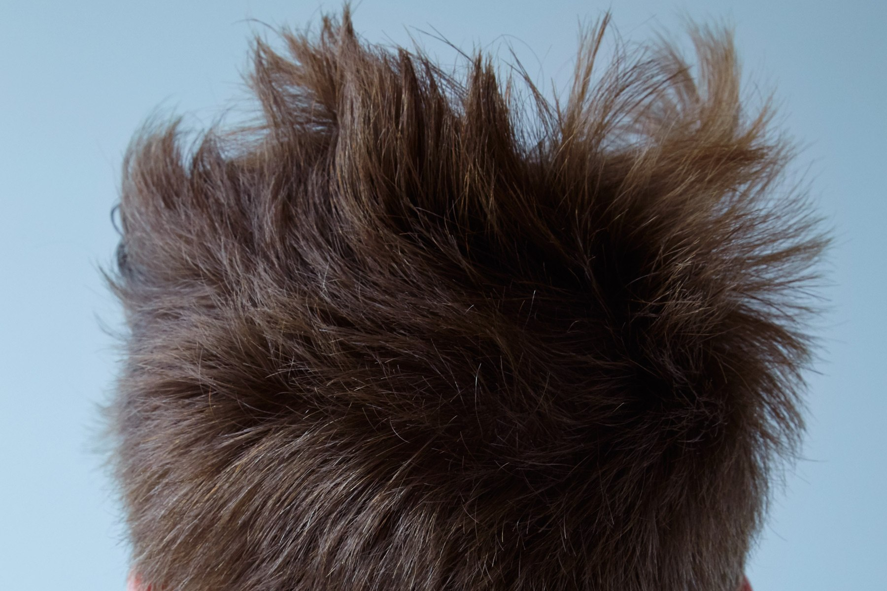 Detail shot of model Matt Pitt's hair, photographed by Alexander Thompson, with men's grooming by Yuhi Kim, for Ponyboy magazine in New York City.