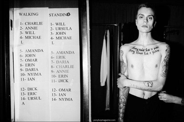 Male model Ian Welgarz photographed getting dressed, backstage at Devon Halfnight Leflufy F/W16 menswear show. Photography by Alexander Thompson for Ponyboy magazine.