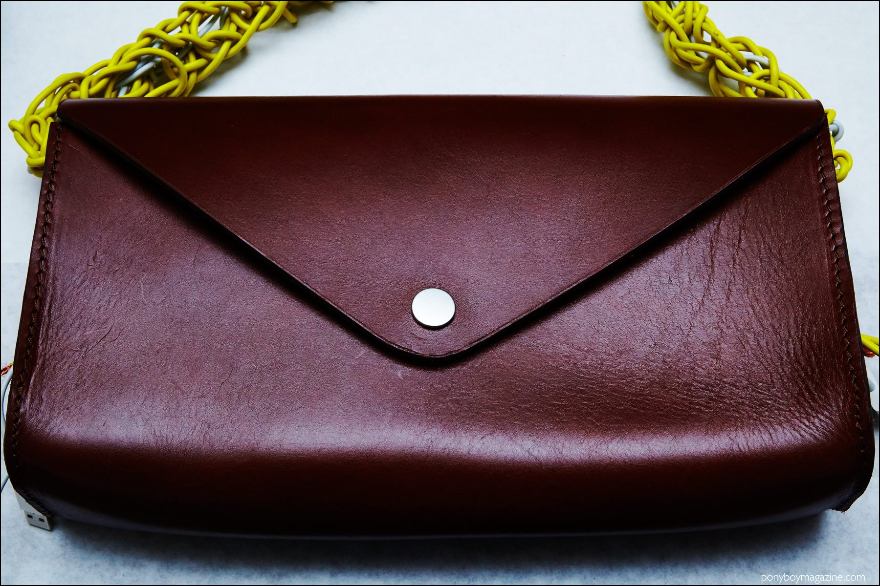 A detail shot of a men's brown bag designed by Devon Halfnight Leflufy, for Fall/Winter 2016. Photograph by Alexander Thompson for Ponyboy magazine NY.