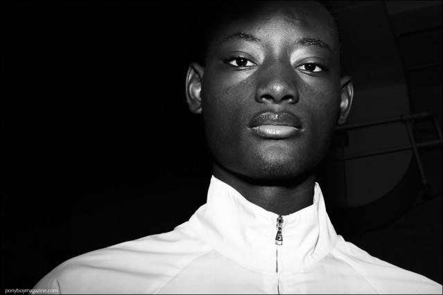 Model Youssouf Bamba photographed backstage at Duckie Brown F/W16 menswear show. Photography by Alexander Thompson for Ponyboy magazine.