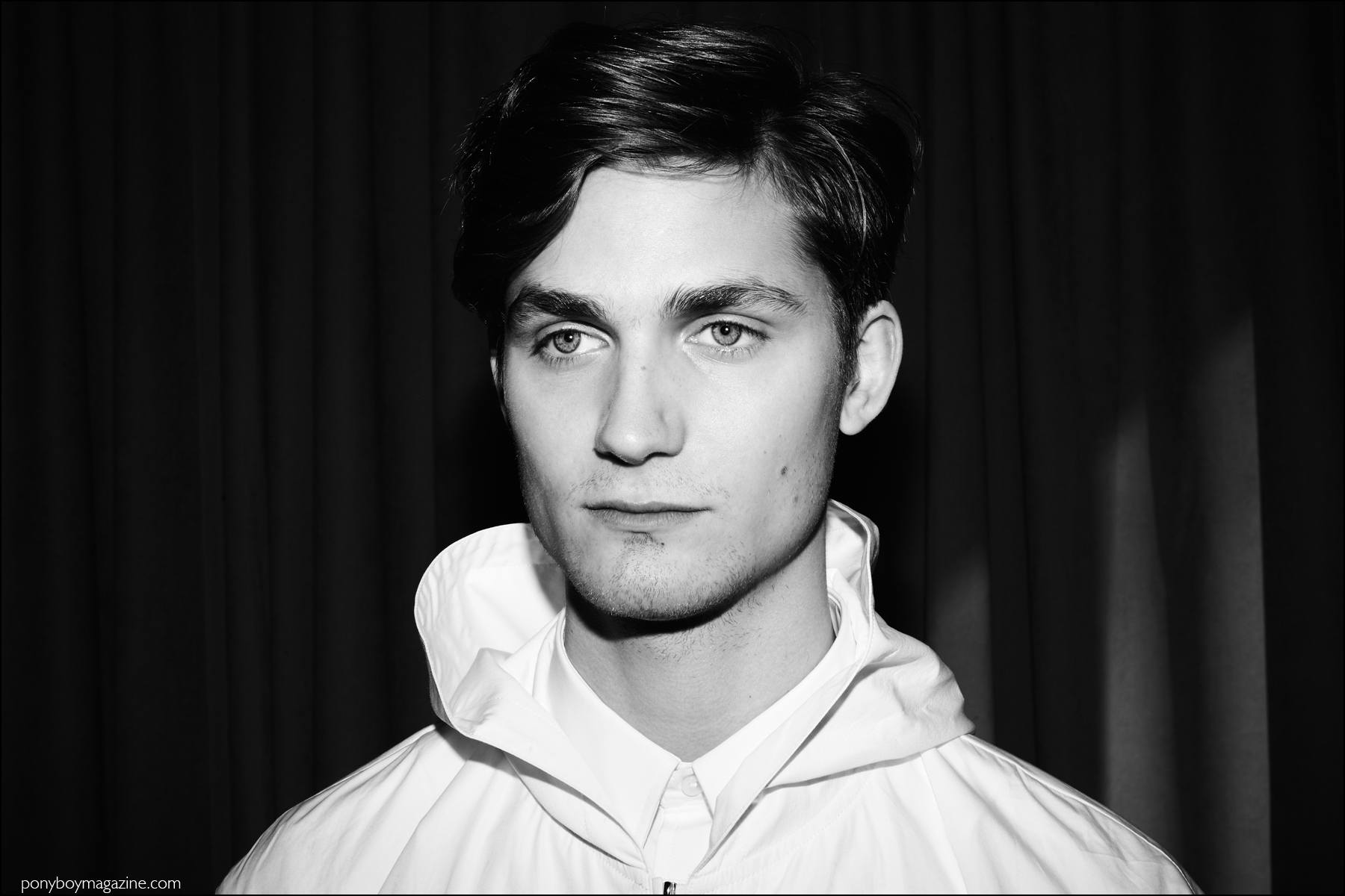 Black and white portrait of male model Paul-Alexandre Haubtmann photographed backstage in Duckie Brown F/W16 menswear. Photography by Alexander Thompson for Ponyboy magazine NY.