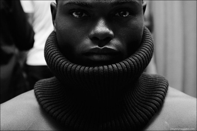 Close-up photograph of a male model in a neck warmer, backstage at Gypsy Sport F/W 2016. Photography by Alexander Thompson for Ponyboy magazine.