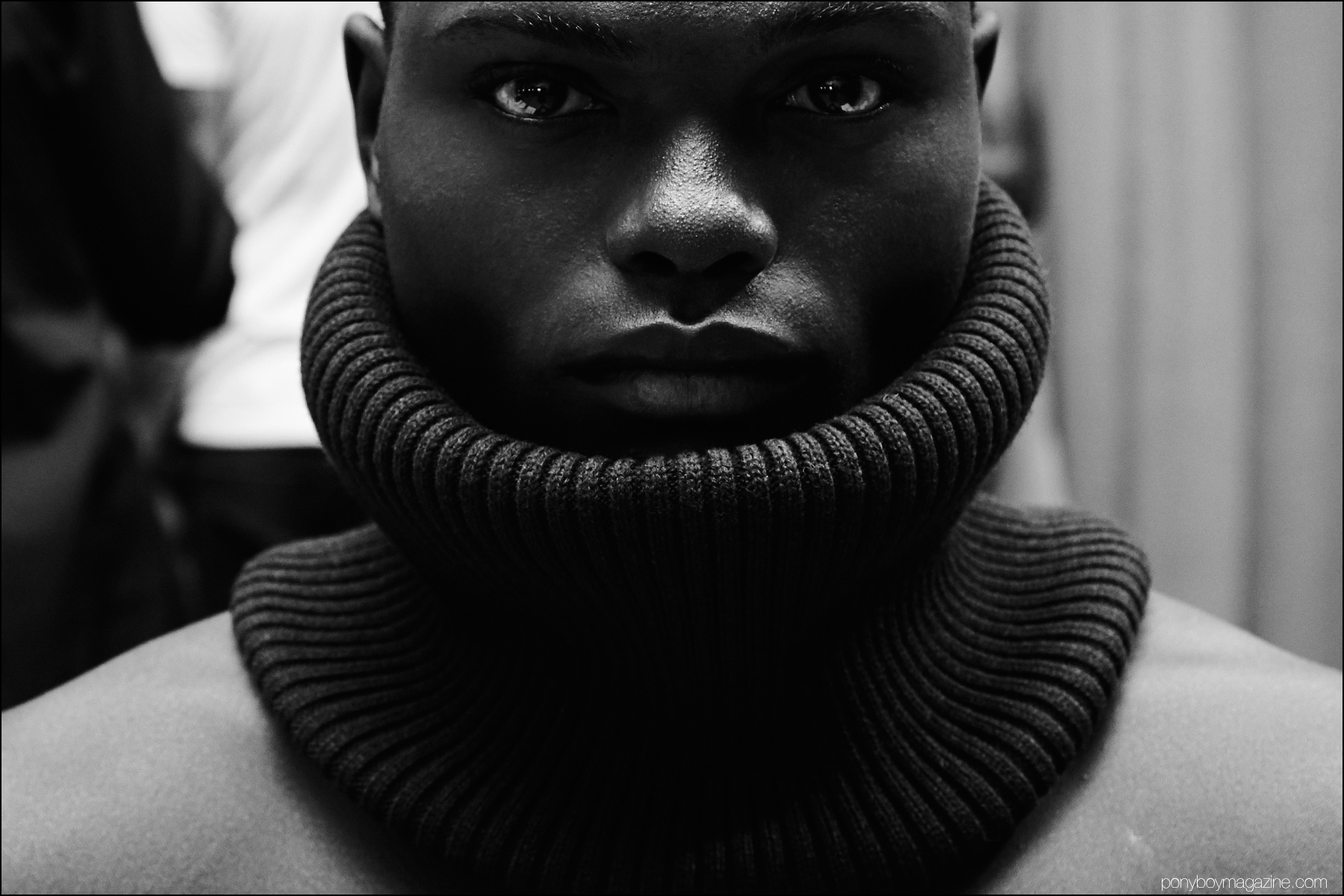 Close-up photograph of a male model in a neck warmer, backstage at Gypsy Sport F/W 2016. Photography by Alexander Thompson for Ponyboy magazine NY.