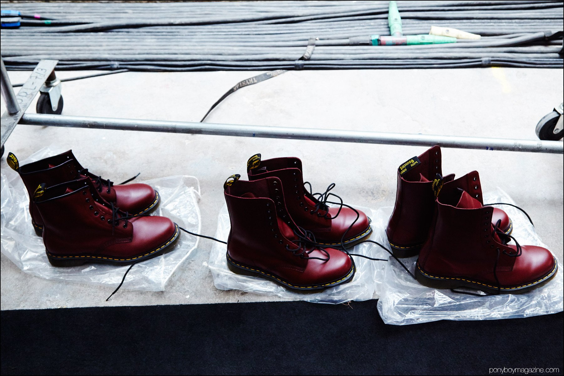 Red Doc Marten combat boots photographed backstage at the Siki Im + Den Im F/W16 menswear show. Photography by Alexander Thompson for Ponyboy magazine NY.
