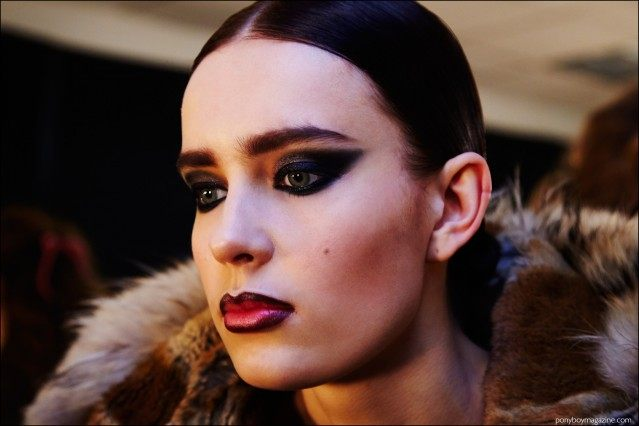 Dramatic makeup photographed on a model, backstage at Georgine F/W16 womenswear show. Photography by Alexander Thompson for Ponyboy magazine.
