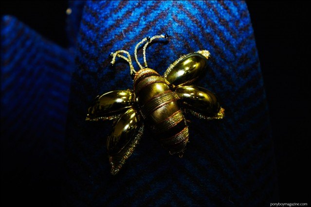 Detail shot of a bumble bee brooch, photographed backstage at the Georgine F/W16 show. Photography by Alexander Thompson for Ponyboy magazine.