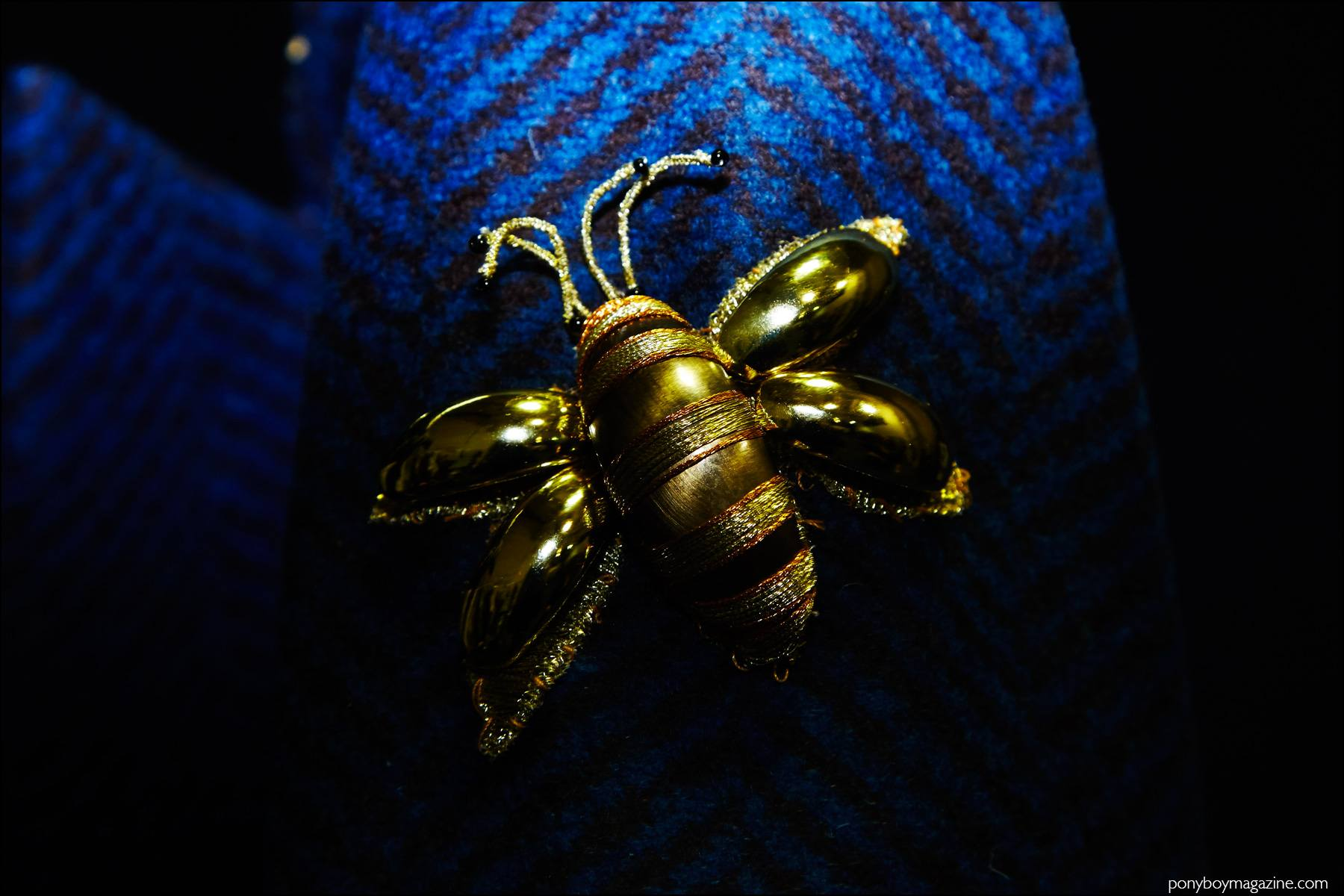 Detail shot of a bumble bee brooch, photographed backstage at the Georgine F/W16 show. Photography by Alexander Thompson for Ponyboy magazine NY.